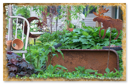 Wrought Iron Garden Stakes - Rusted Moose and Rusted Moon Garden Stakes Shown
