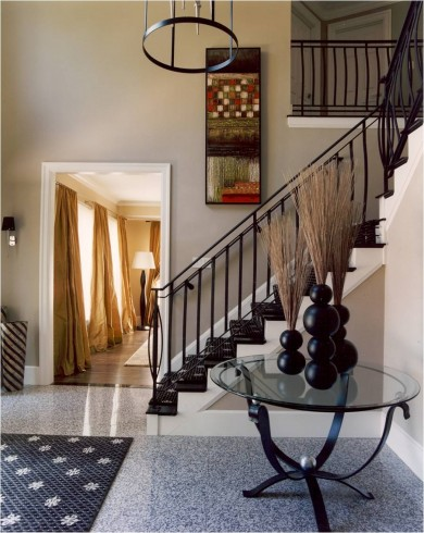 Create an inviting foyer with wrought iron decor for Wrought iron home decorations