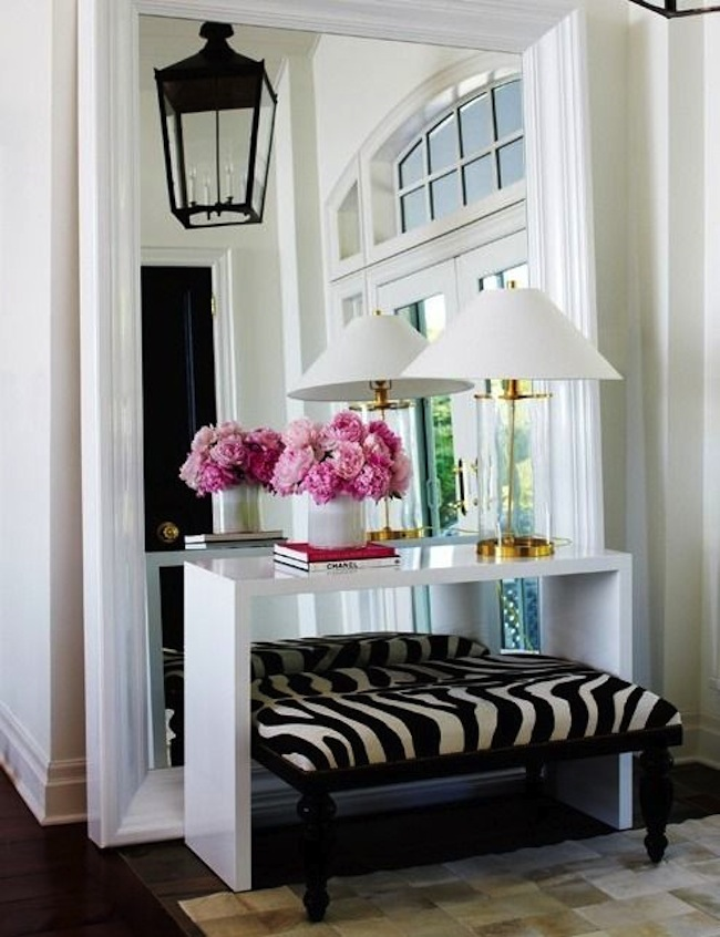 Creating a stunning layered effect in this contemporary entryway is a ...