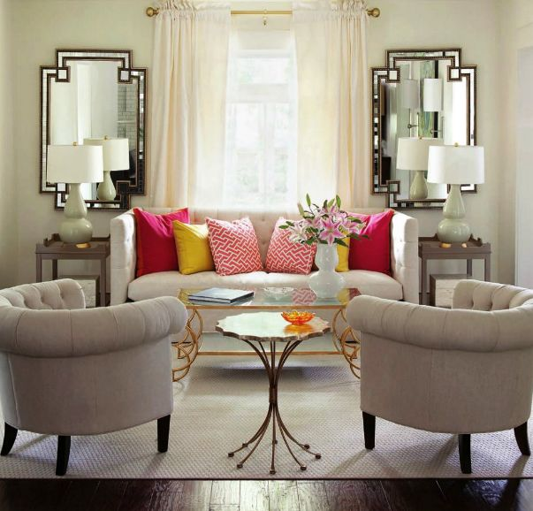 Marvelous Symmetry And Balance Reign In This Small, But Chic, Living Room. Matching  End Tables With Mirrors Behind Create A Balanced Look On Either End Of The  Sofa, ...