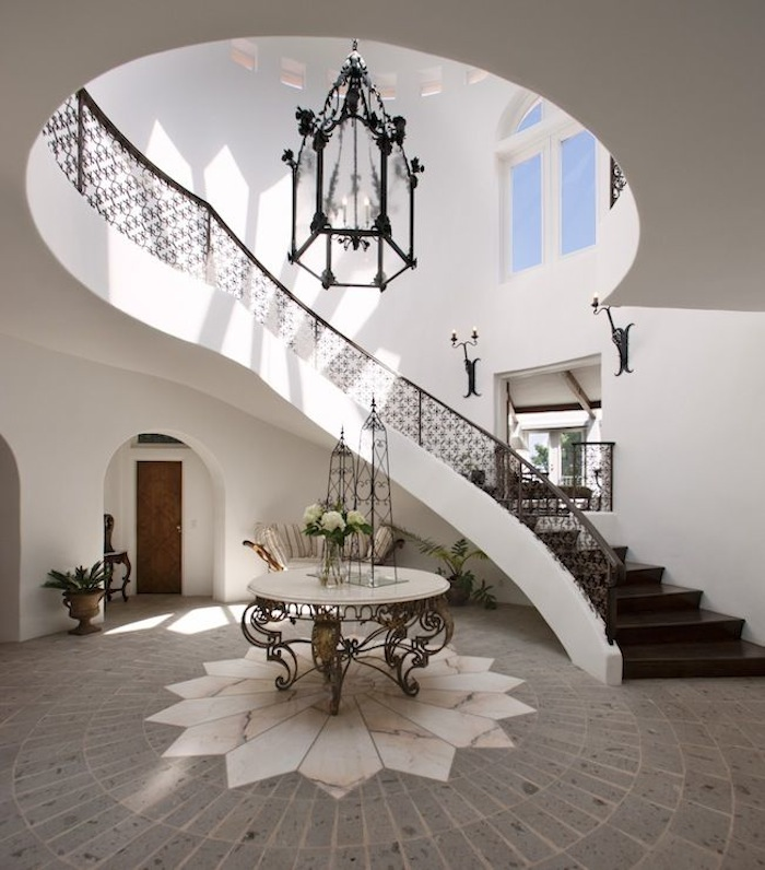 And Perfect For A Grand Curved Entryway Is This Exquisite Scrolled Iron  Table Base With Marble Top. With Wrought Iron Seen Around The Space And On  The ...