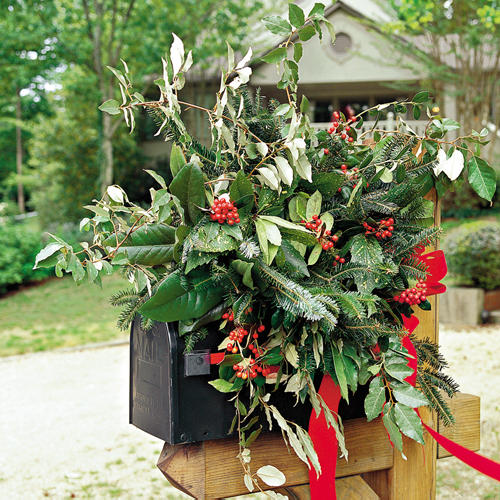 fresh greenery top a country mailbox for a pretty natural look